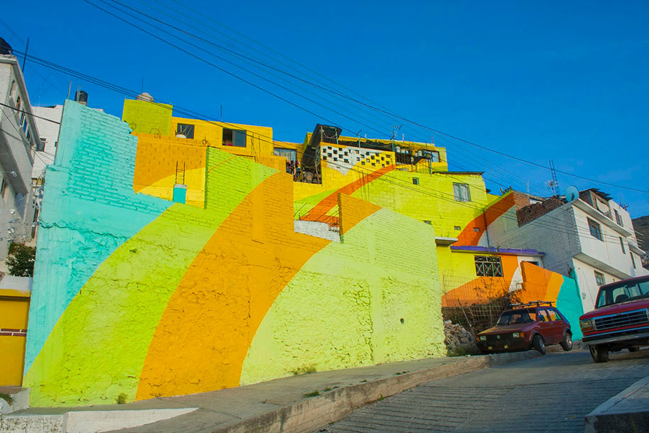 To Unite The Community Against Violence Artists Paint A Mural On 200 Houses -2