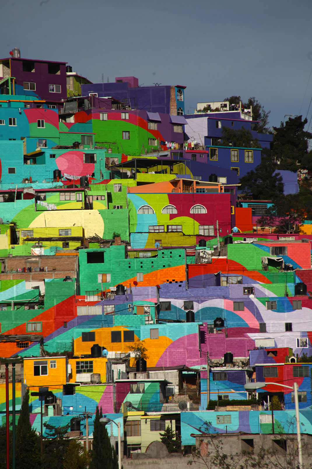 To Unite The Community Against Violence Artists Paint A Mural On 200 Houses -6