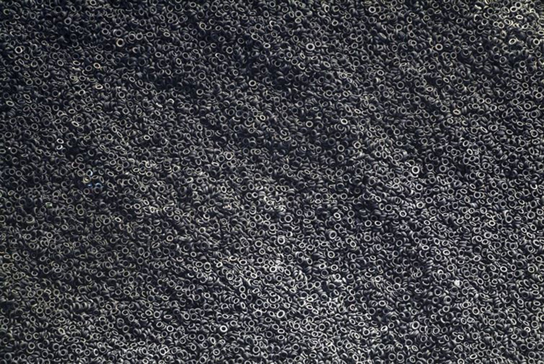 The aerial view of a landfill of used tires