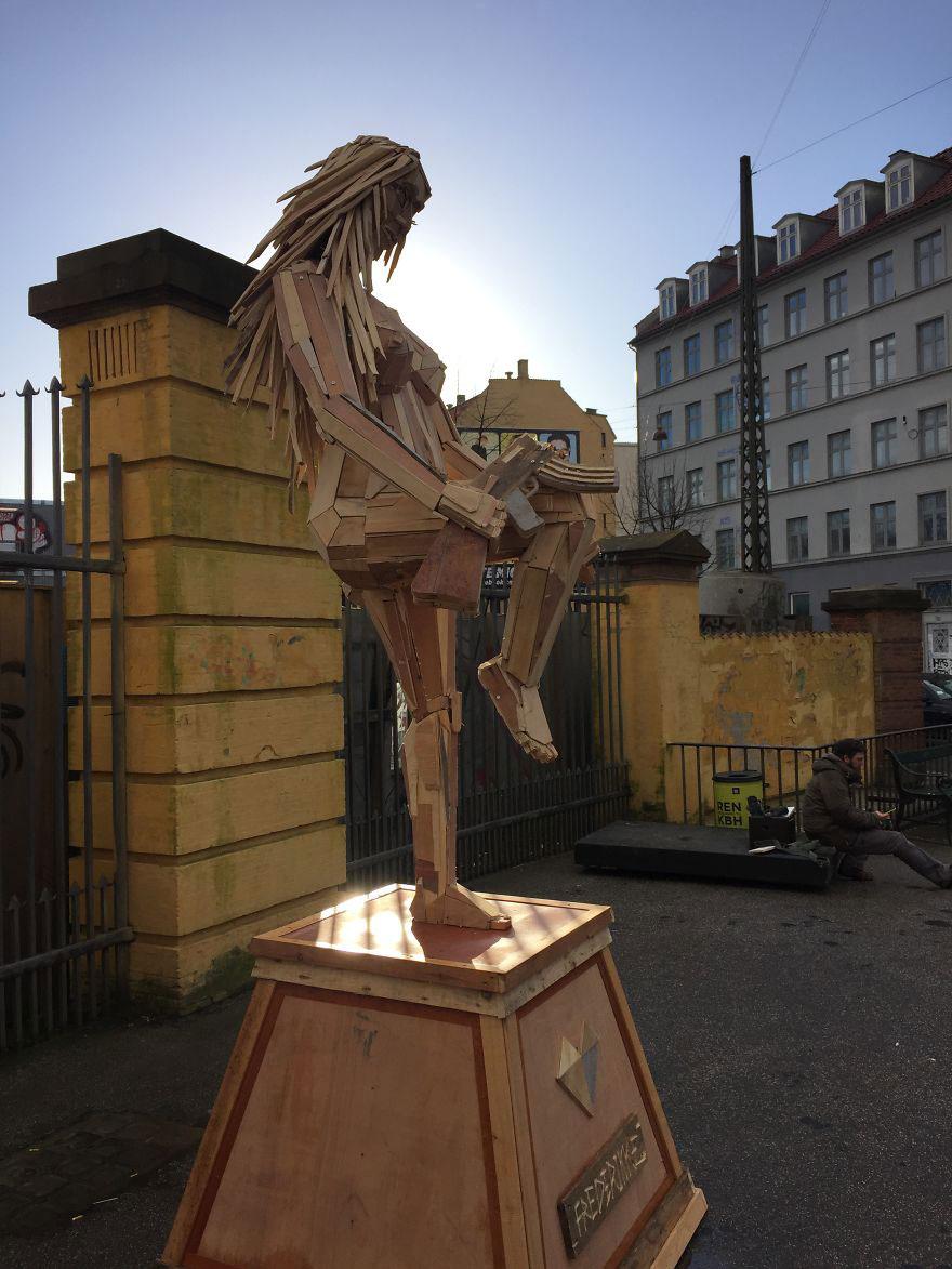 gigantic wooden sculptures made using simple wood debris