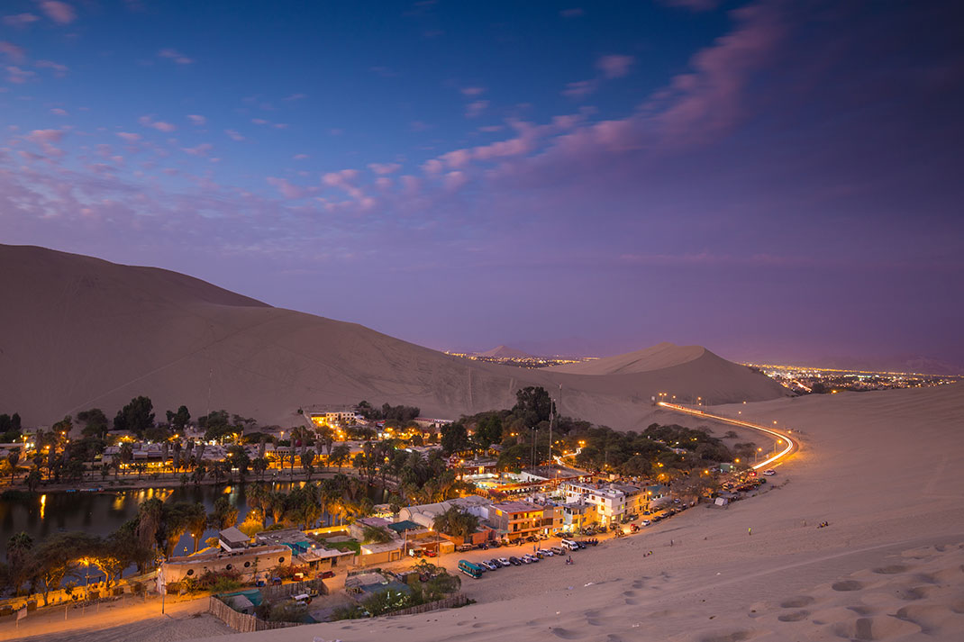 huacachina the beautiful small village built around peruvian desert oasis. Black Bedroom Furniture Sets. Home Design Ideas