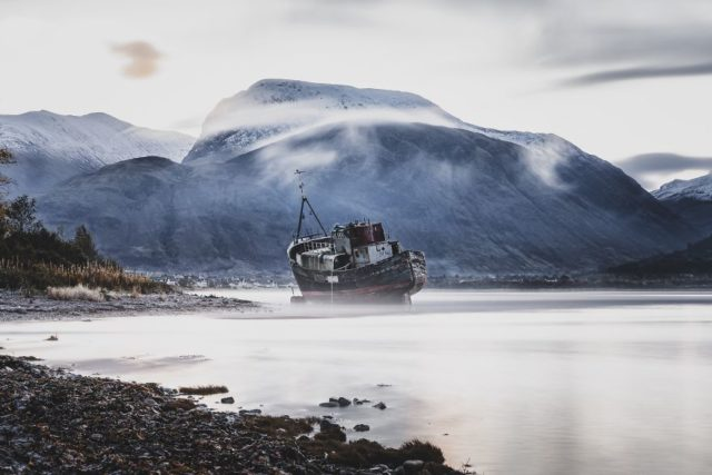 An Abandoned Boat With The Highest Mountain Of UK In Back Ground