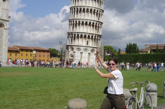 Funny Tourist Holding the Leaning Tower of Pisa