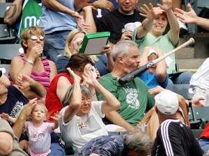Baseball bat in the air hit on a man face