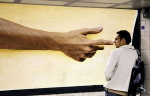 A big hand pointing a man