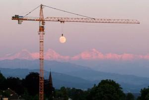 seems as moon is hang through a crane