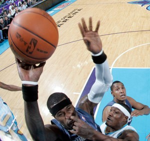 Basketball players trying to snatch ball