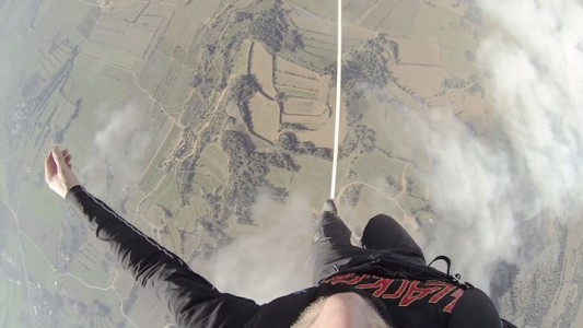 Amazing Stunt Of Walking On A Tightrope Between Two Air Balloons Above Clouds-8
