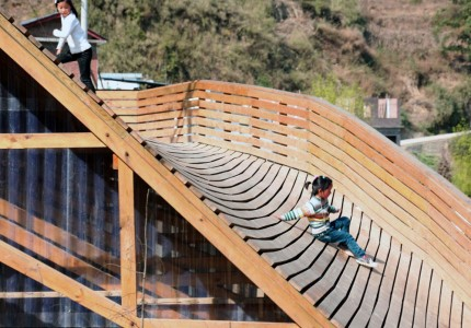 The Pinch: An Amazing Community Library With Double Roof Curved As Slide-4