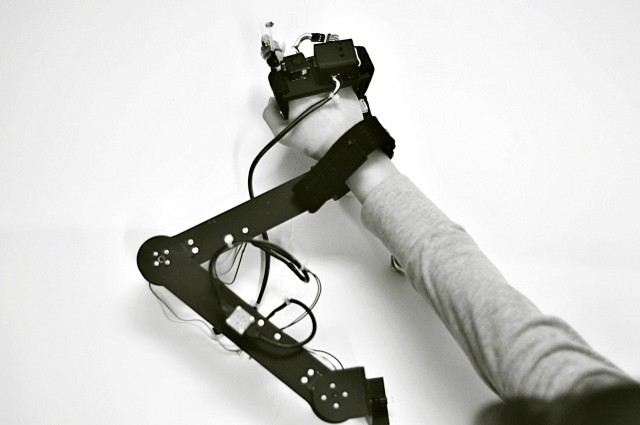 This Revolutionary Robotic Glove Teaches Anyone To Draw -1