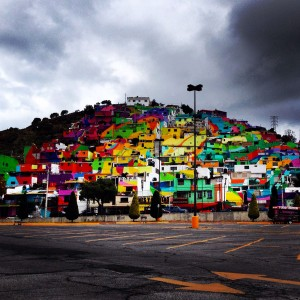 To Unite The Community Against Violence Artists Paint A Mural On 200 Houses -12