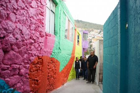 To Unite The Community Against Violence Artists Paint A Mural On 200 Houses -7
