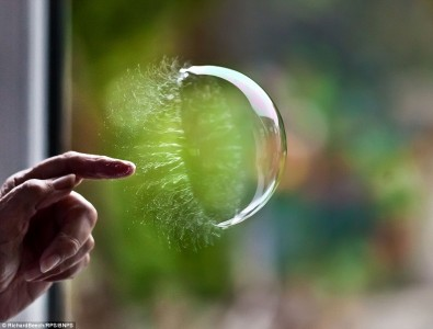 The moment a bubble is burst using finger
