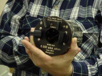 knobs securing the voltmeter