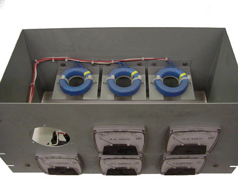 Toroidal current transformers scale high current levels down for application to 5 A full-scale AC ammeters.